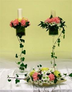 Dekoracja sali weselnej - świece i kwiaty