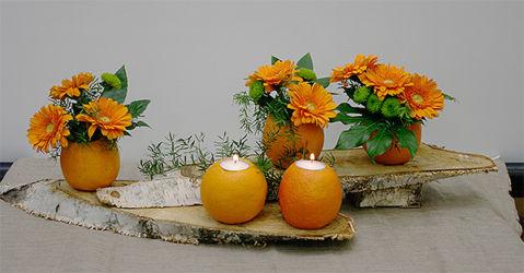 Dekoracja florystyczna z pomarańczowymi gerberami